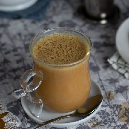 teh tarik in a glass, milky tea