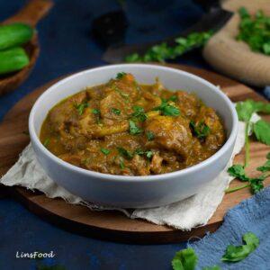 Ayam Assam Serani in a white bowl