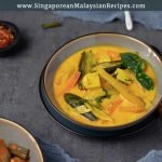 sayur lemak photo yellow vegetable curry in a bowl