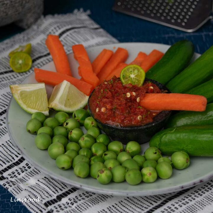 sambal belacan with sliced vegetables and calamansi lime