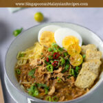mee rebus (egg noodles) topped with eggs, tofu, chillies limes and gravy pinterest