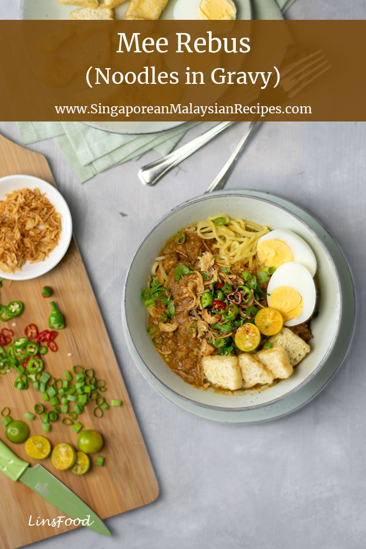 mee rebus photo (egg noodles) topped with eggs, tofu, chillies limes and gravy