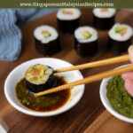dipping sushi in kaffir lime kosho and soy sauce mix