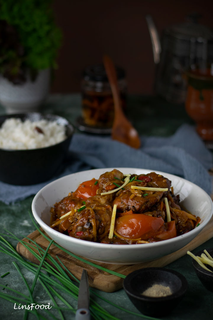 Ayam Masak Kicap (Chicken in Soy Sauce) in a white bowl with julienned ginger