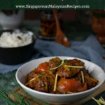 Ayam Masak Kicap (Chicken in Soy Sauce) in white bowl with tomatoes and ginger slices